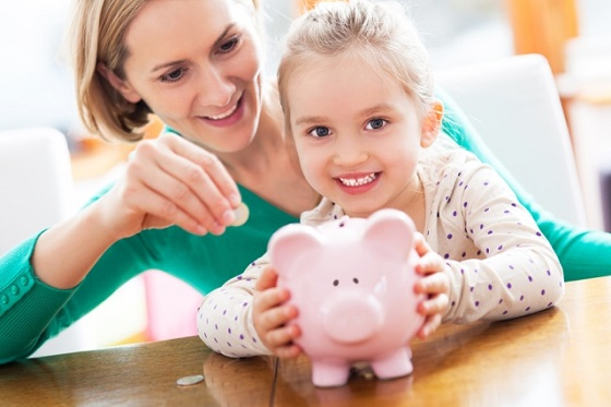 mother and daughter and a piggy bank
