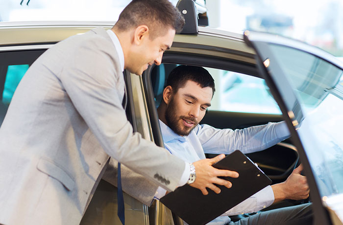Sales person showing details to a buyer