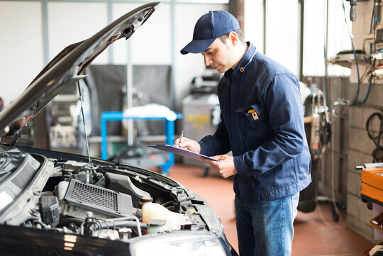 Engineer carrying out an MOT test