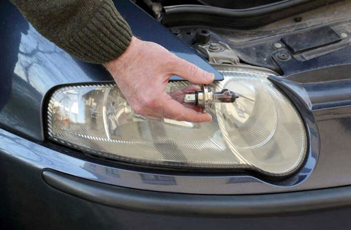 Man holding car headlight
