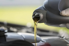 Pouring oil into car