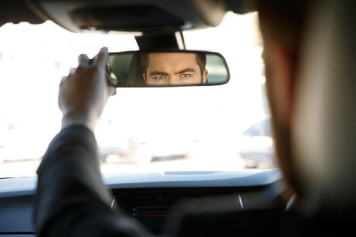 Driver looking in rear view mirror