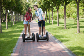 Couple on segways kissing