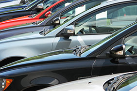 A row of cars in a dealership