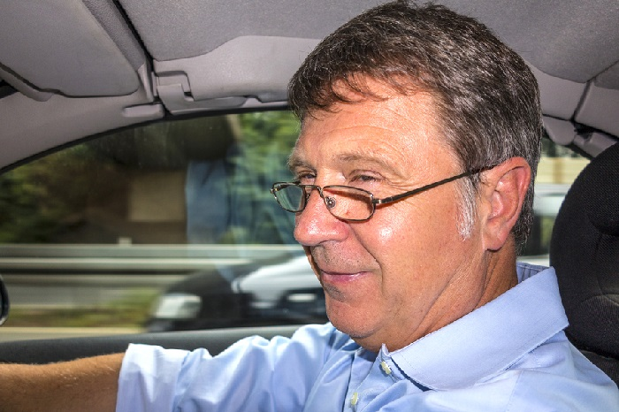 Smiling driver wearing glasses