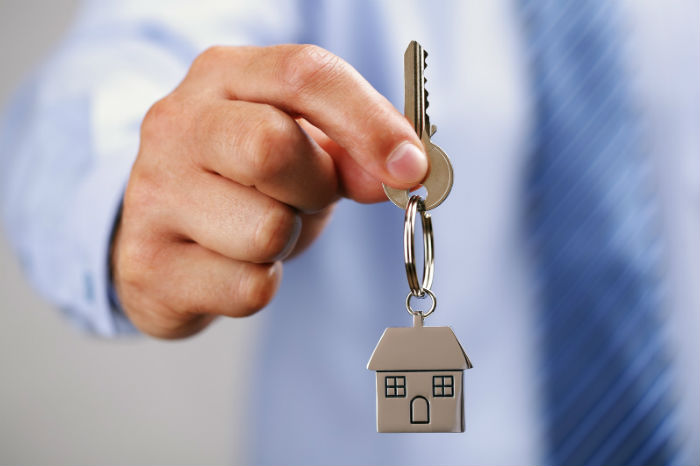 Estate agent holding house keys