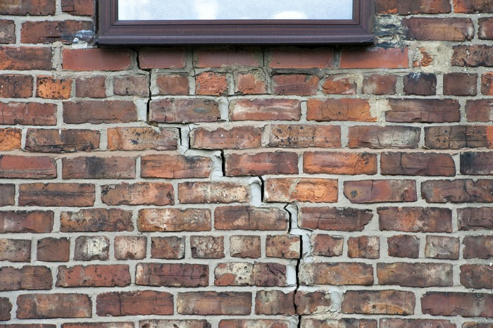 A brick wall showing signs of subsidence