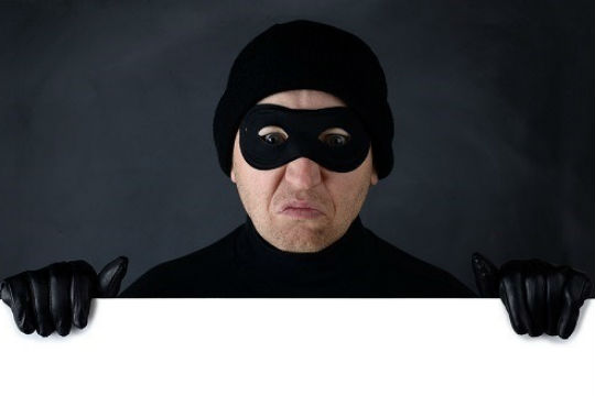 Robber wearing a mask