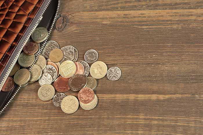 pound coins on a table