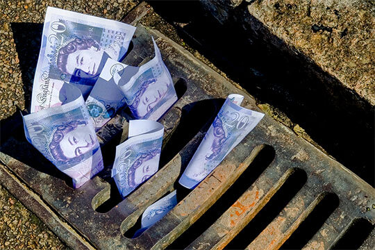 £20 notes in a drain