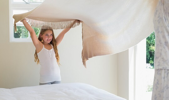 Child making the bed