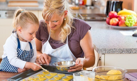 Mother and child baking