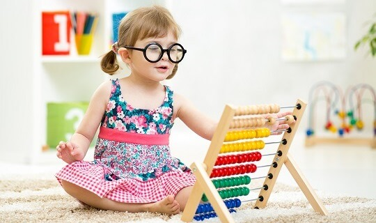 Child playing with an abacus