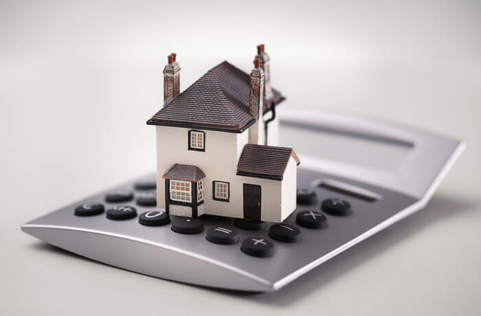 Model house on top of a calculator