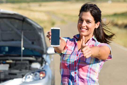 Woman with phone at car accident