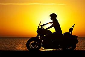 Motorbike in front of a sunset