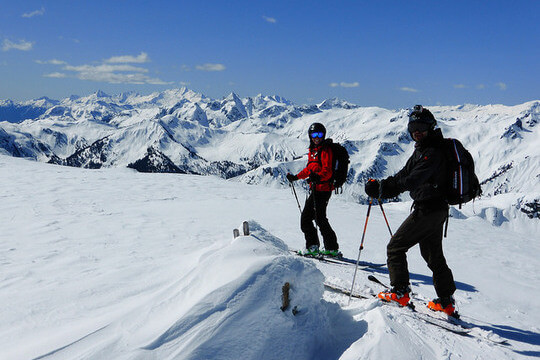 Two off-piste skiers
