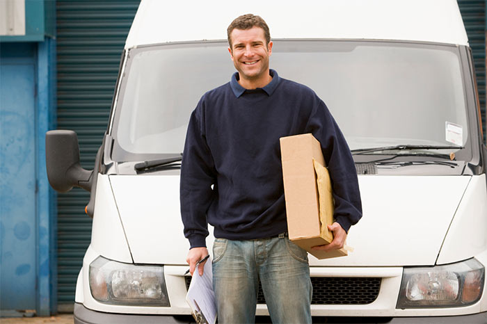 Delivery man near a van